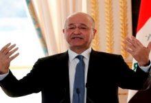 صورة الرئيس العراقي: قمة بغداد ليست أرضية لبقاء القوات الأجنبية في البلاد