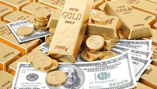 صورة الذهب يرتفع وآمال لتحفيزات أميركية على الدولار