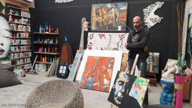 """صورة فنان يزين شوارع البحرين بلوحات """"الكاليغرافيتي"""""""