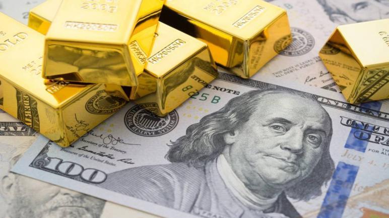 هبوط الذهب وصعود الدولار وعوائد سندات الخزانة الأميركية